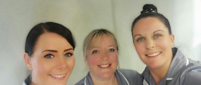 3 smiling Premier Homecare carers
