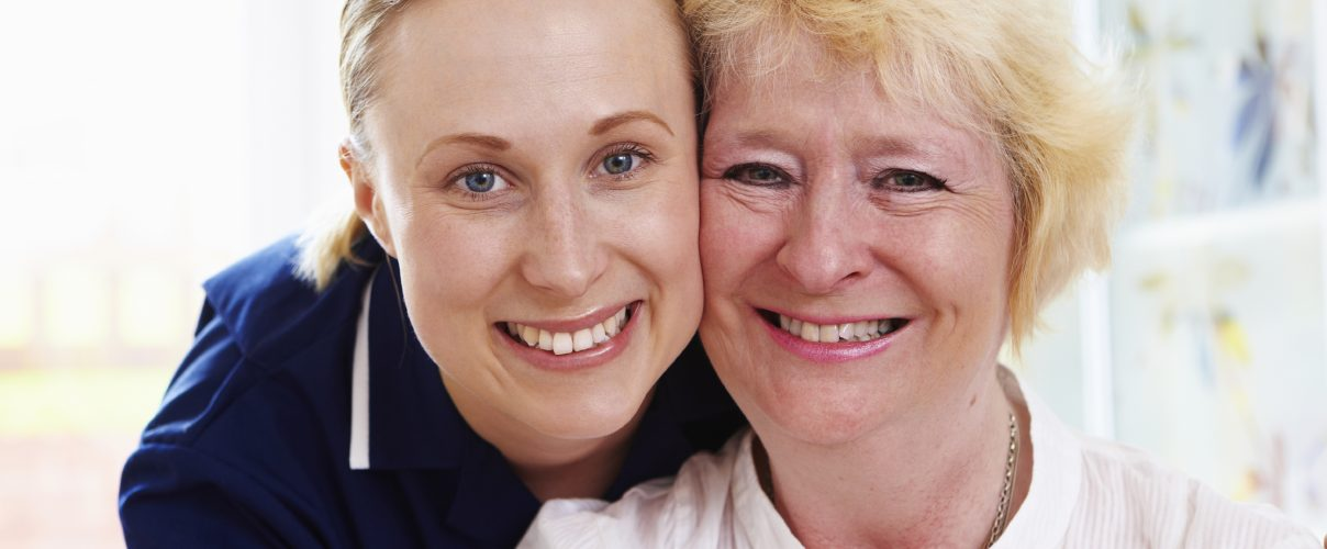 close up Portrait of senior woman with care worker